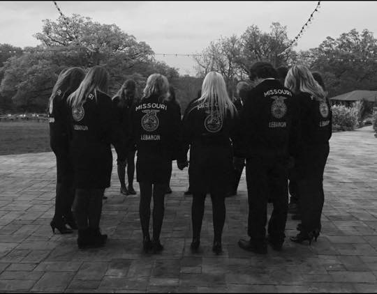 We Stand Together: Huddled in a circle the 2018-2019 Lebanon FFA Officers join in prayer over the upcoming year. Despite the differences that are among the team, they stand together in unity symbolizing the acceptance of FFA.