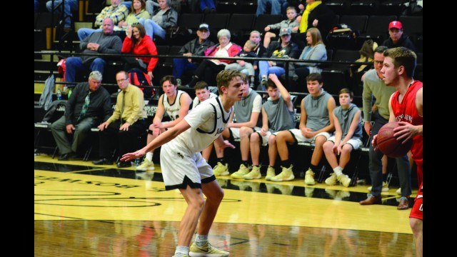 In+his+zone.+Ethan+defends+against+a+West+Plains+Zizzer+at+a+varsity+basketball+game.+The+Yellowjackets+won.+