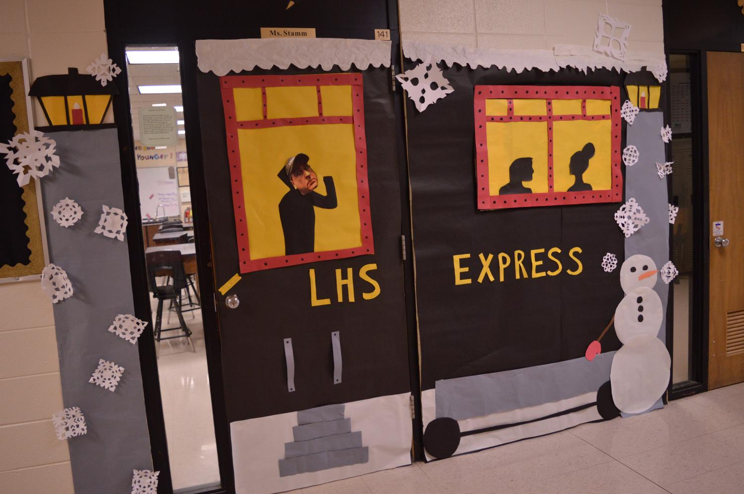 OVERALL CONTEST WINNER!  Ms. Stamm's Class!   Science and Art Hallway Theme: Christmas Movies