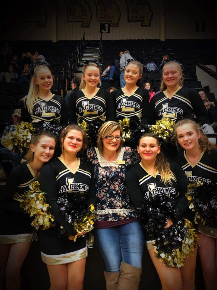 The JV cheer team poses for a picture with their coach Leighanne Phipps after their first home game. This game was against Branson and they had a blast pumping up the crowd.  Picture courtesy of Krista White