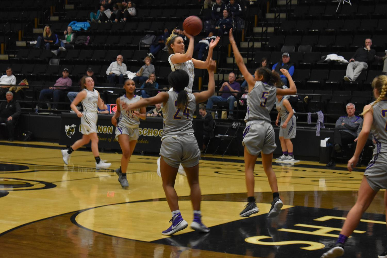Photo one: photo by: Braeden Slavens Senior Kamryn Mack takes her shot. The Lebanon Lady Yellow Jacket basketball team had a great season thanks to Coach Payne. The Girls has a 14-10 winning streak and competed in the district championship game.