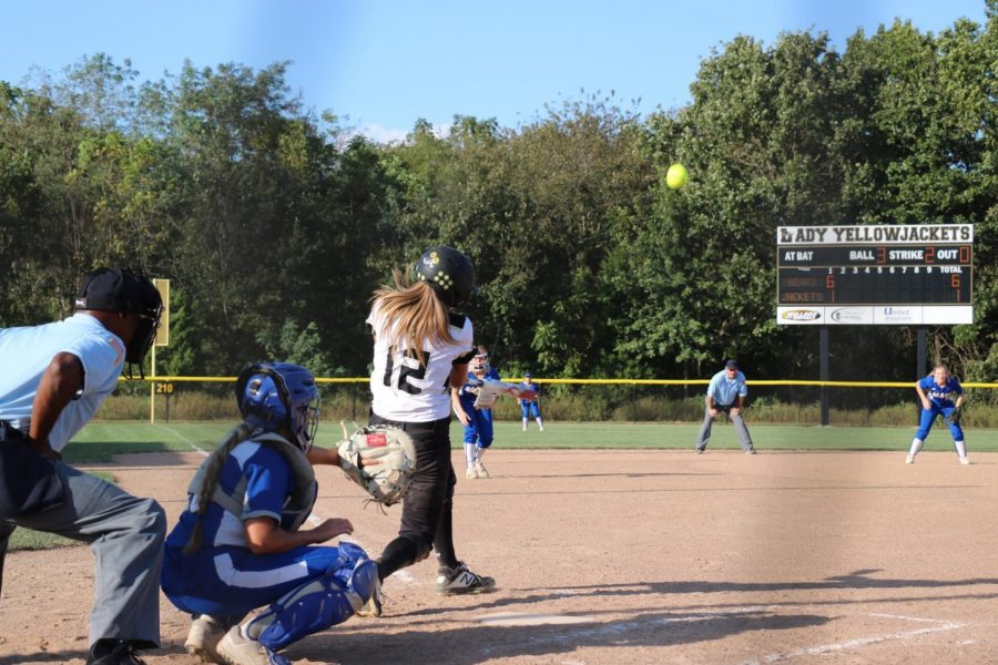 GOING, GOING, GONE. Freshman Raegan McCowan puts all her strength into her swing and hits a line drive against Ava at Lady Yellowjackets Stadium. McCowan has helped lead the team in hits, RBIs, and home runs.