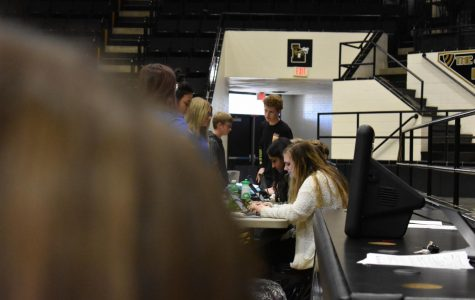 The Yearbook staff tags and logs club members that made it to the picture day for their club. Currently, Onyx Carroll is helping on the line, as well as Mansi Patel and Garrett Nelson.