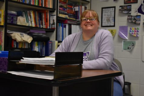 Honors History teacher, Mrs. Perschall, sits at her desk ready for day of teaching students.
