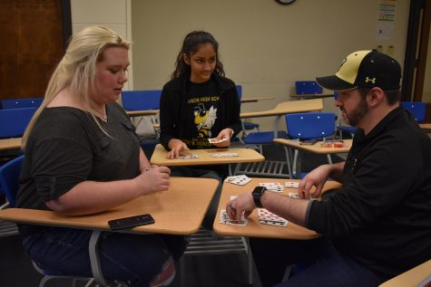 Leah Boyce, Mansi Patel, and Mr. Slye playing rummy, to pass the time before the awards assembly. Many of the members of Science Olympiad played card games to pass the time but this also help them get used to each other.